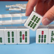 Touch a mahjong tiles - Stock Photo
