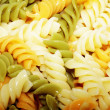 Spiral pasta in boiling hot water — Stock Photo #10239508