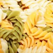 Spiral pasta in boiling hot water — Stock Photo