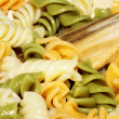 Spiral pasta in boiling hot water — Stock Photo #10239600