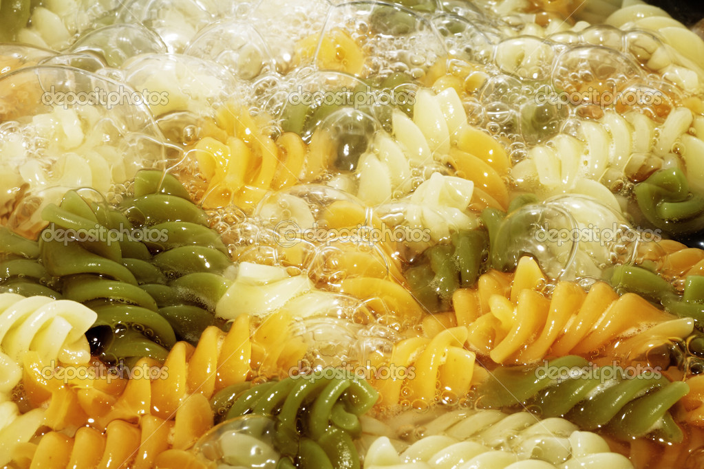 Spiral pasta in boiling hot water Close — Stock Photo #10239213