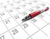 Red pen on a calendar — Stock Photo