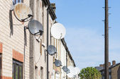 Row of satellite dishes — Stock Photo