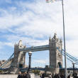 LONDON, UK - APRIL 30: Olympic flag with Tower Bridge in the bac - Stock Photo