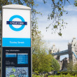 LONDON, UK - APRIL 30: A bicycle hire sign with Tower Bridge in — Stock Photo
