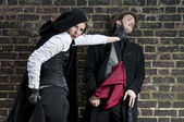 VIctorian woman strangling man — Stock Photo