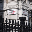 Stock Photo: LONDON, UK - APRIL 02: Downing Street nameplate in corner wi