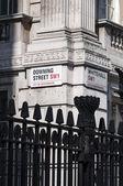 LONDON, UK - APRIL 02: Downing Street nameplate in the corner wi — Stock Photo