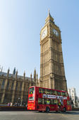 LONDON, UK - APRIL 02: Famous red double-decker bus driving by H — Stock Photo