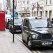 Stock Photo: Black cabs parked in New Bond street in London, UK.
