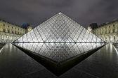 PARIS 2010: Louvre pyramid at night on October — Stock Photo