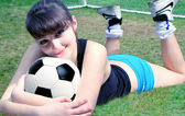 Woman with a soccer ball — Stok fotoğraf