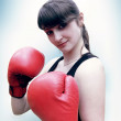 Stock Photo: Woman boxer wearing gloves