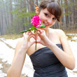 A woman with a rose — Stock Photo