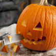 Stock Photo: Carving pumpkin