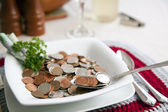 Cost of living with spoonful — Stock Photo