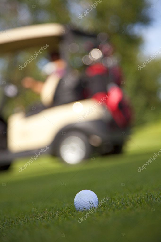 A golf ball sits on the fairway waiting for the golfer to come. — Stock Photo #10146237