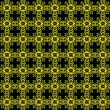 Yellow and green motifs wallpaper on black background — Stock Photo