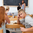 Teenagers studying together in a class — Stock Photo