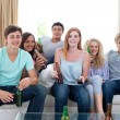 Friends drinking beer at home — Stock Photo #10277826