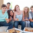 Adolescents eating pizza at home — Stok fotoğraf