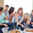 Teenagers eating pizza at home — Stock Photo #10277835