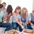 Stock Photo: Adolescents eating pizza at home