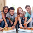 Friends eating pizza at home — Stock Photo #10277847