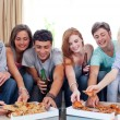 Stock Photo: Teenagers eating pizzat home