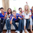 Teenagers watching a football match in the living-room — Stock Photo #10277864