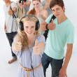 Happy teenagers smiling at the camera — Stock Photo