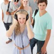 Happy teenagers smiling at the camera — Stockfoto #10277901