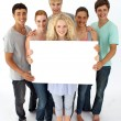 Foto Stock: Group of teenagers holding a blank card