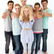 Group of teenagers standing in front of the camera with thumbs u — ストック写真