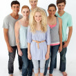 Group of teenagers standing in front of the camera — Stock Photo #10277945