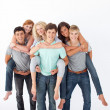 Teenagers giving their friends piggyback rides — Stock Photo #10277980