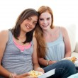 Young girls eating burgers and fries — Stock Photo