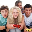 Excited teenagers playing video games in the living-room — Stock Photo #10278042