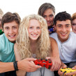 Portrait of teenagers playing video games in the living-room — Stock Photo #10278047