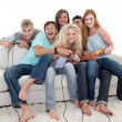 Teenagers playing video games at home — Stock Photo #10278064