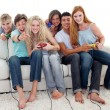 Friends playing video games in the living-room — Stock Photo #10278067