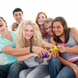 Stock Photo: Teenagers playing video games in living-room