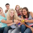 Teenagers playing video games in living-room — Stock Photo #10278071
