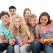 Stock Photo: Friends playing video games in the living-room