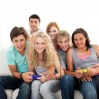 Teenagers playing video games in the living-room — Stock Photo