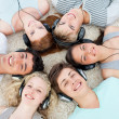 High angle of teenagers listening to music — Stockfoto