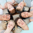 Group of teenagers listening to music — Stock Photo #10278195