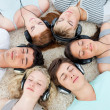 Group of teenagers listening to music — Stock Photo