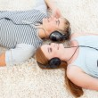 Stock Photo: Couple of teenagers listening to music