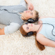 High angle of couple of teenagers listening to music — Stock Photo #10278212